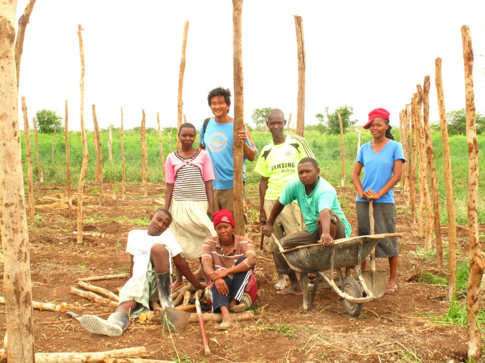 Gabriel with the Idsowe youths involved in a poultry-keeping project to generate income and food (2012) | PHOTO: Tana River Life Foundation